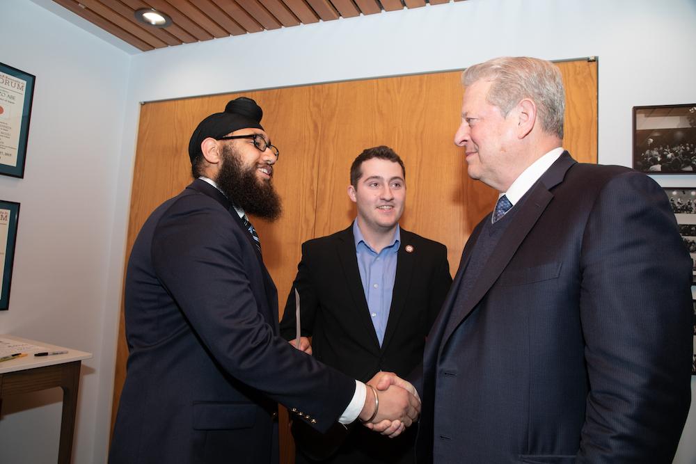 two students meeting Al Gore at Harvard's JFK Jr. Forum