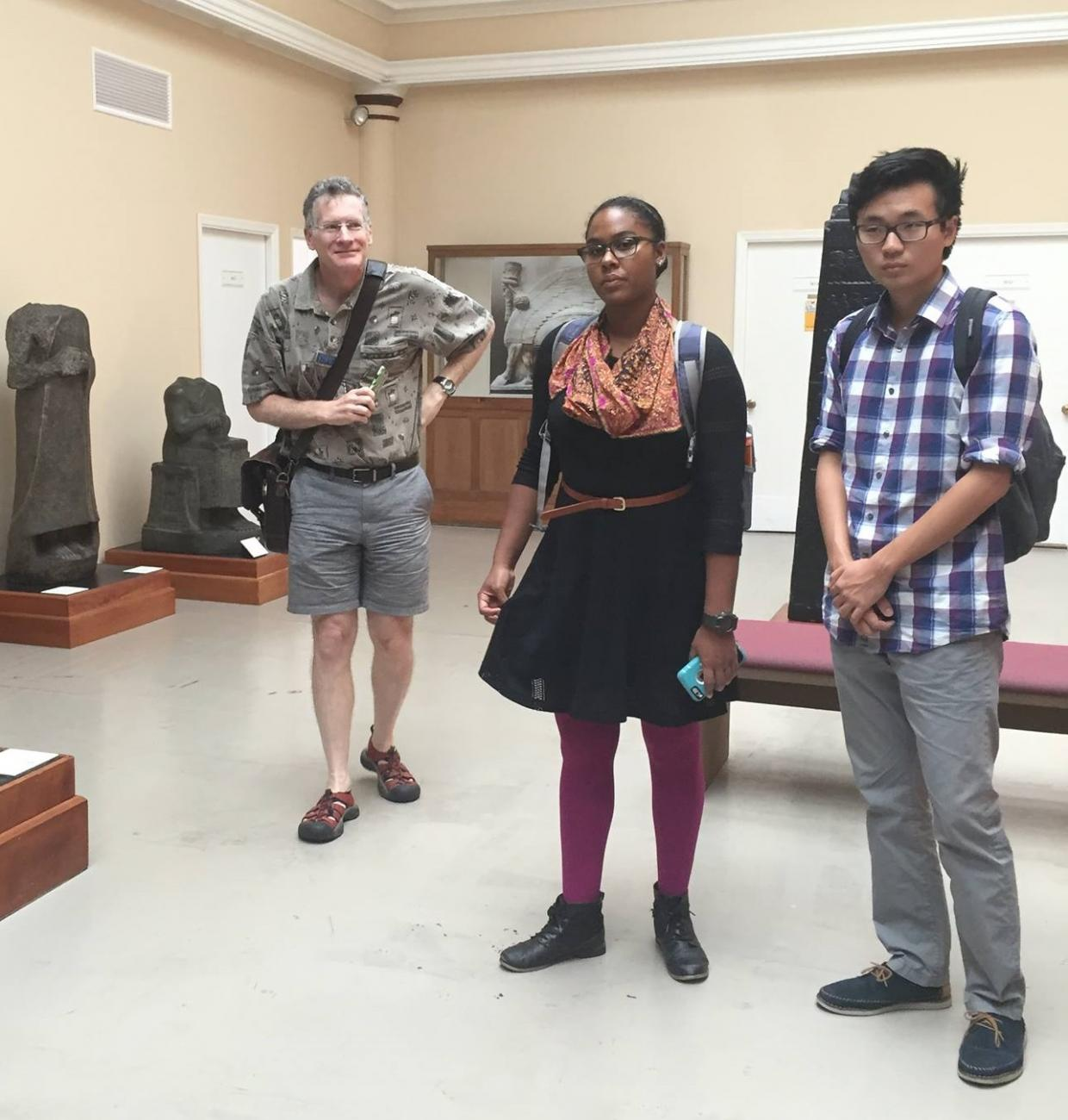three students on a class visit to the Harvard Semitic Museum