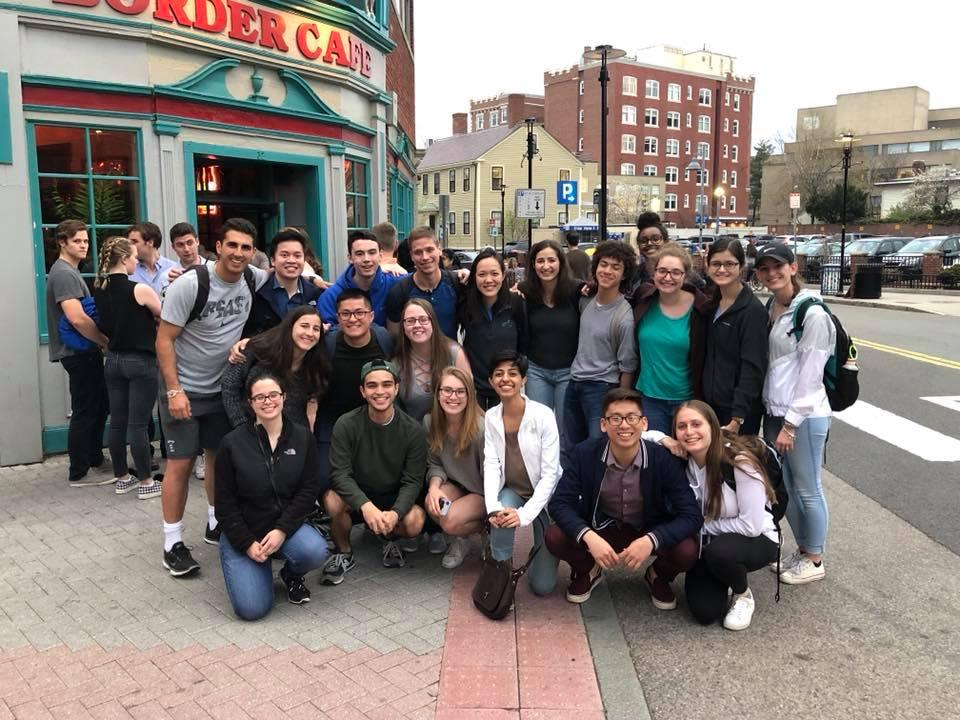A group of students posing for a picture outside of Border Cafe