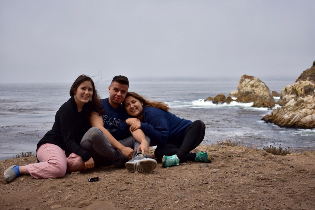 three people on a beach