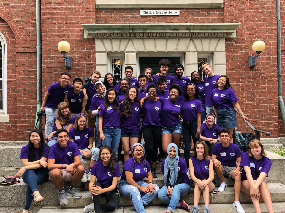 group of students wearing purple