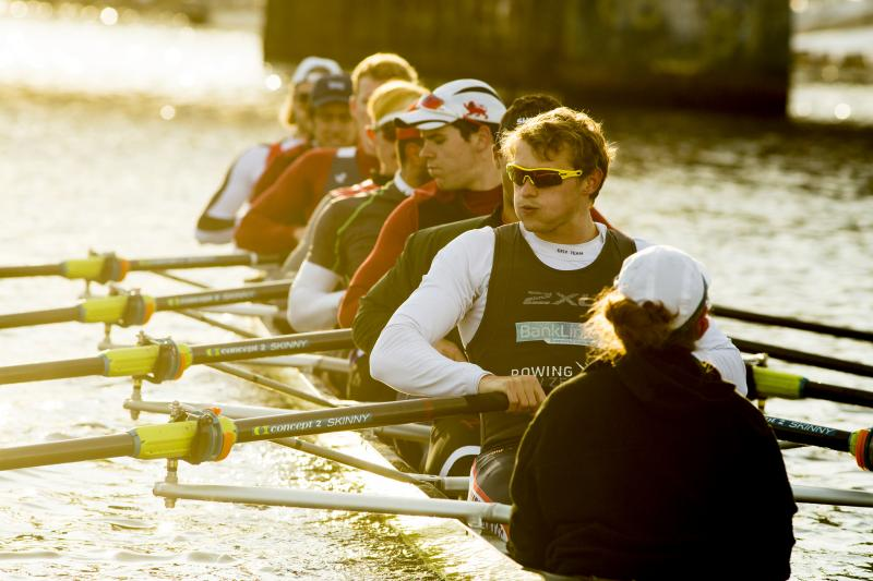 students row  down the Charles river