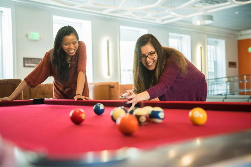 Students playing pool