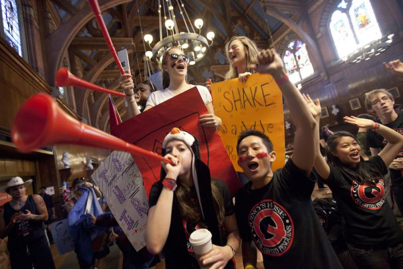 Students celebrating Harvard festivities in dining hall