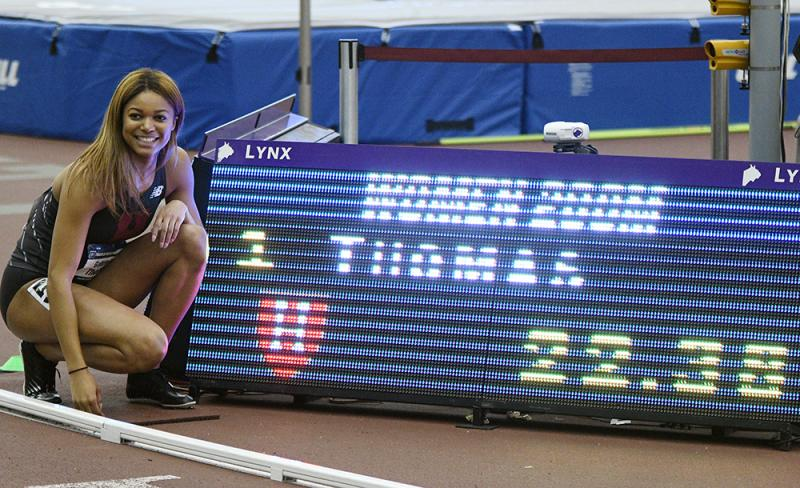 track student next to sign with her race time