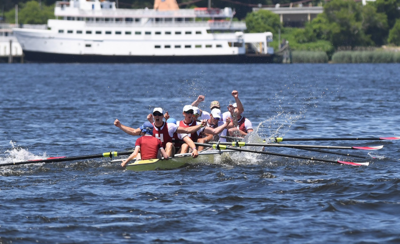 students rowing in Charles River