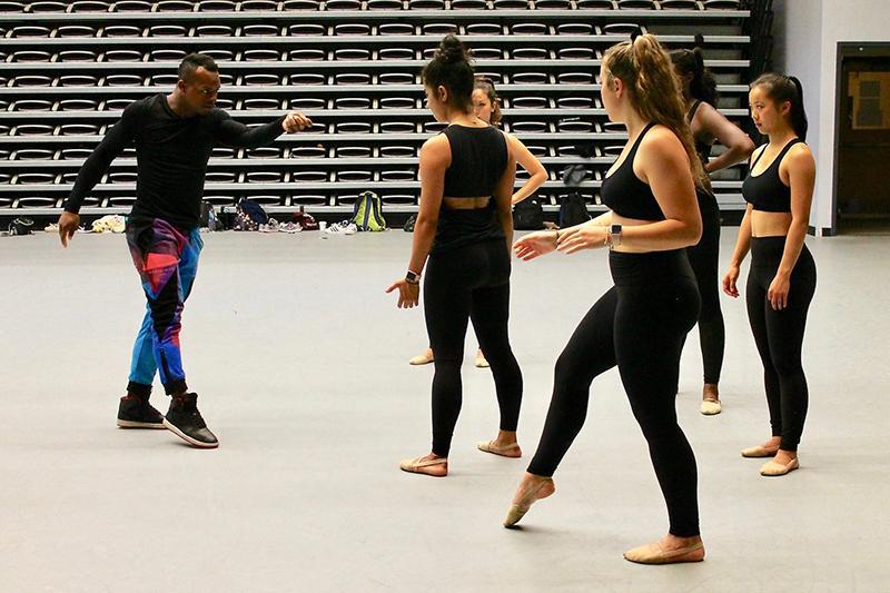 students watching a teacher during a dance class