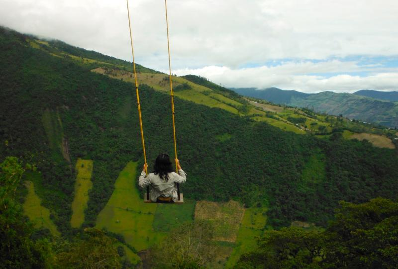 A girl sits on a swing in Ecuador