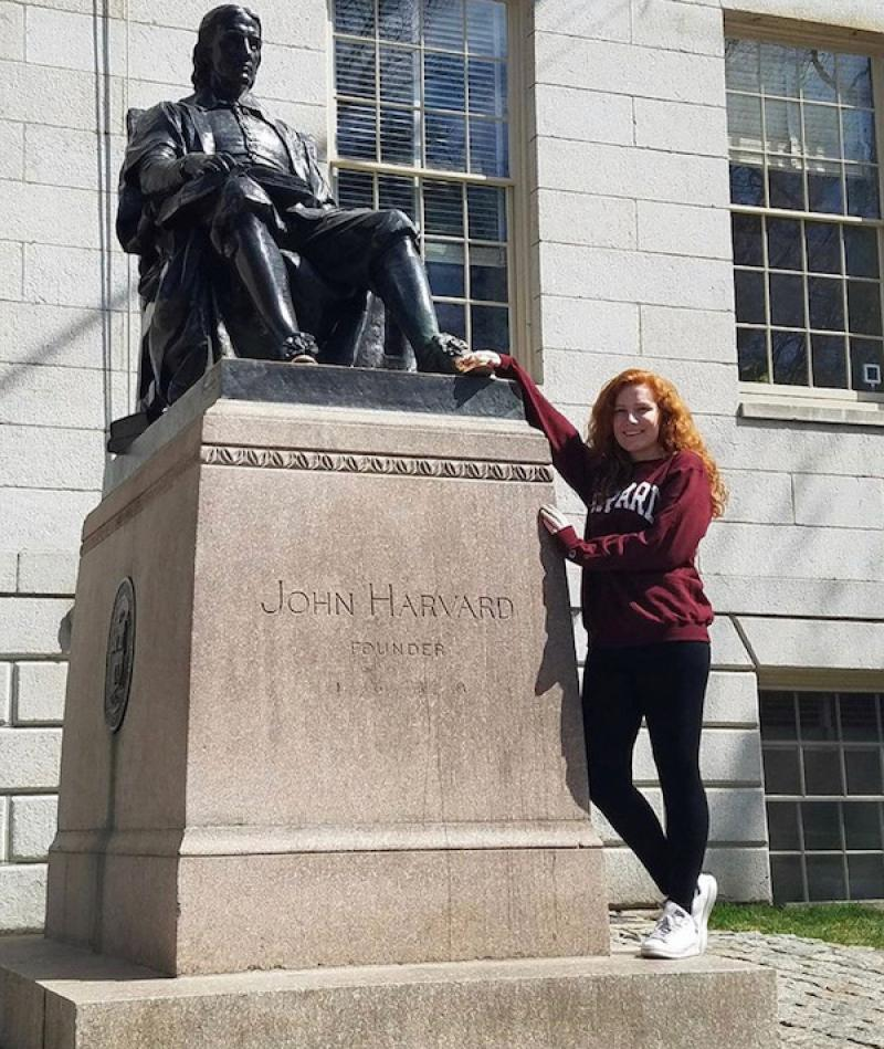 ally touching the john harvard statue