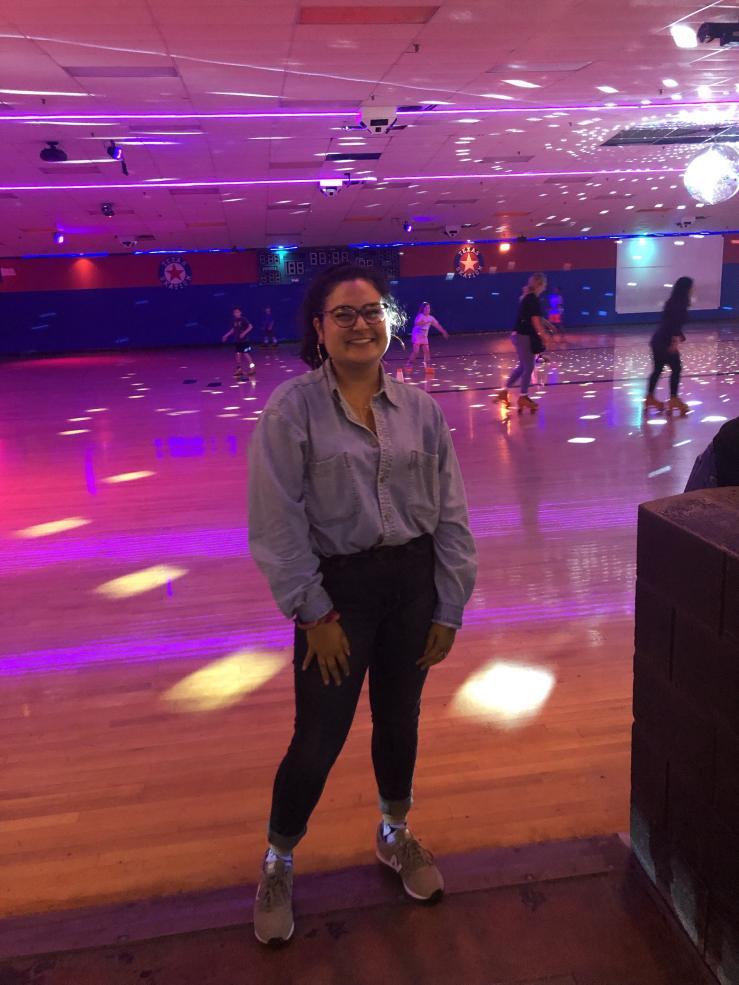 Maria posing in a skating rink.