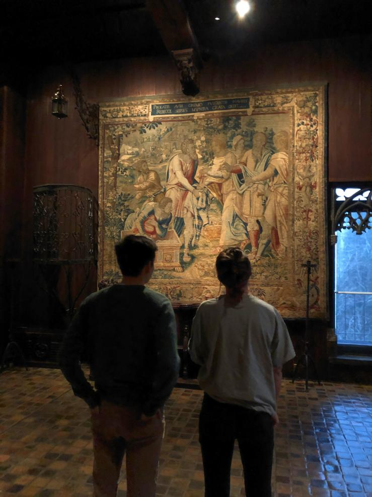 Friends looking at a tapestry in the Isabella Stewart Gardner Museum