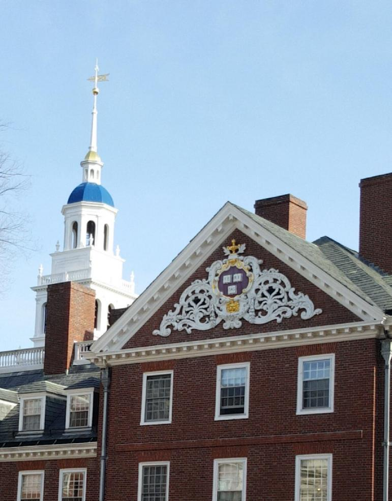 A picture of a Harvard building with a clear, blue sky as the background.