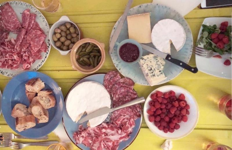 Picnic dinner, with cheese, charcuterie, berries, and bread