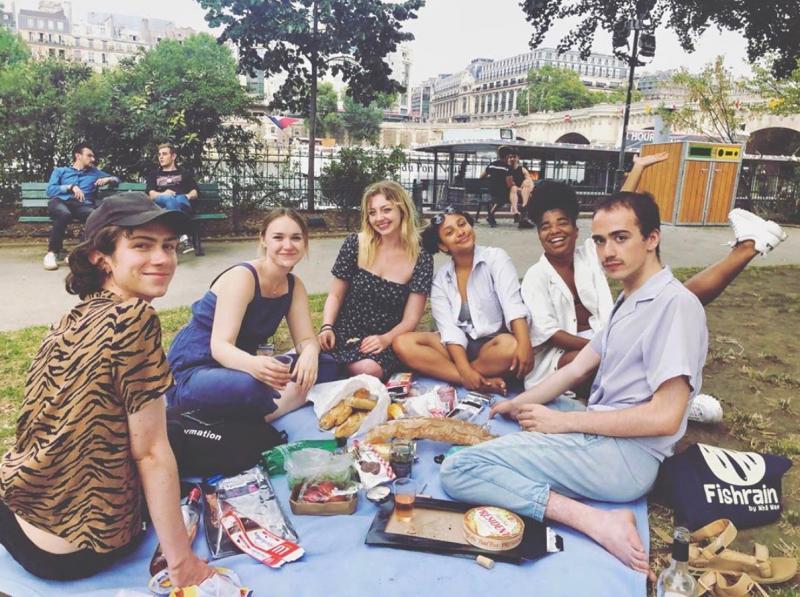 Malia and friends having a picnic by the Seine River