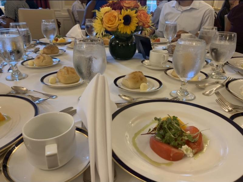 a table with plates of food and teacups