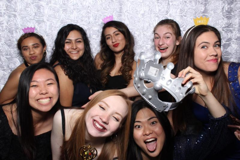 Maria posing with her friends at Quad formal.
