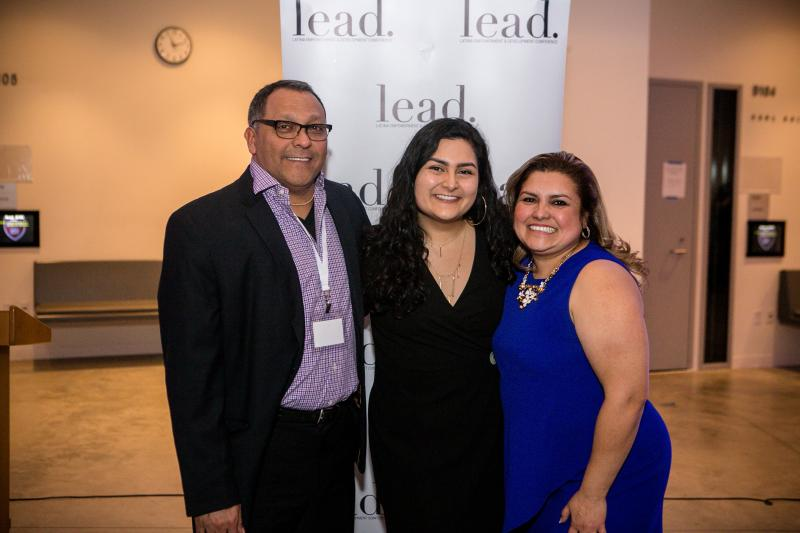 Maria posing with her parents at the LEAD 2019 Conference.