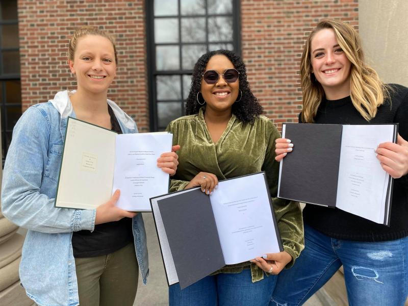 Me and my friends proudly displaying our finished Senior Honors Thesis papers just days before being sent home - March 2020