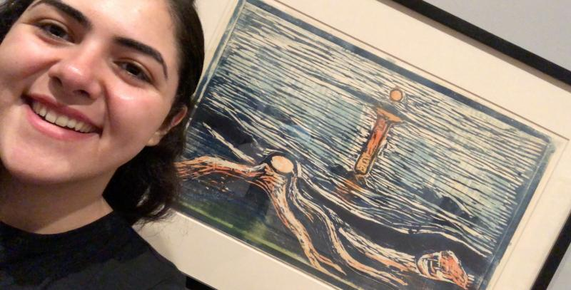 Author taking a picture with a drawing.