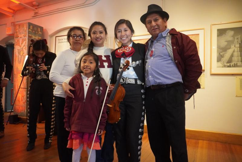 Picture of Amy and her family at her first Mariachi performance