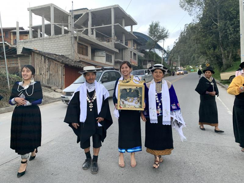 Amy's family participating in a ceremonial procession