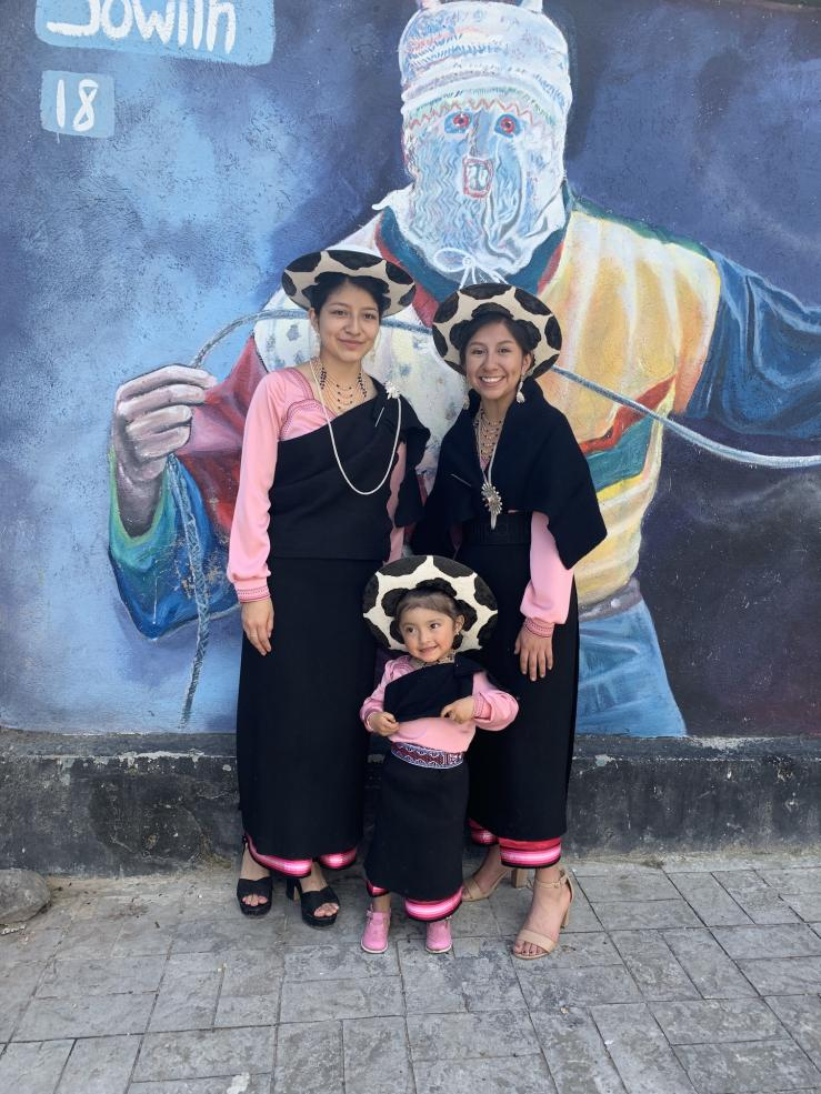 Amy and her family in traditional clothing