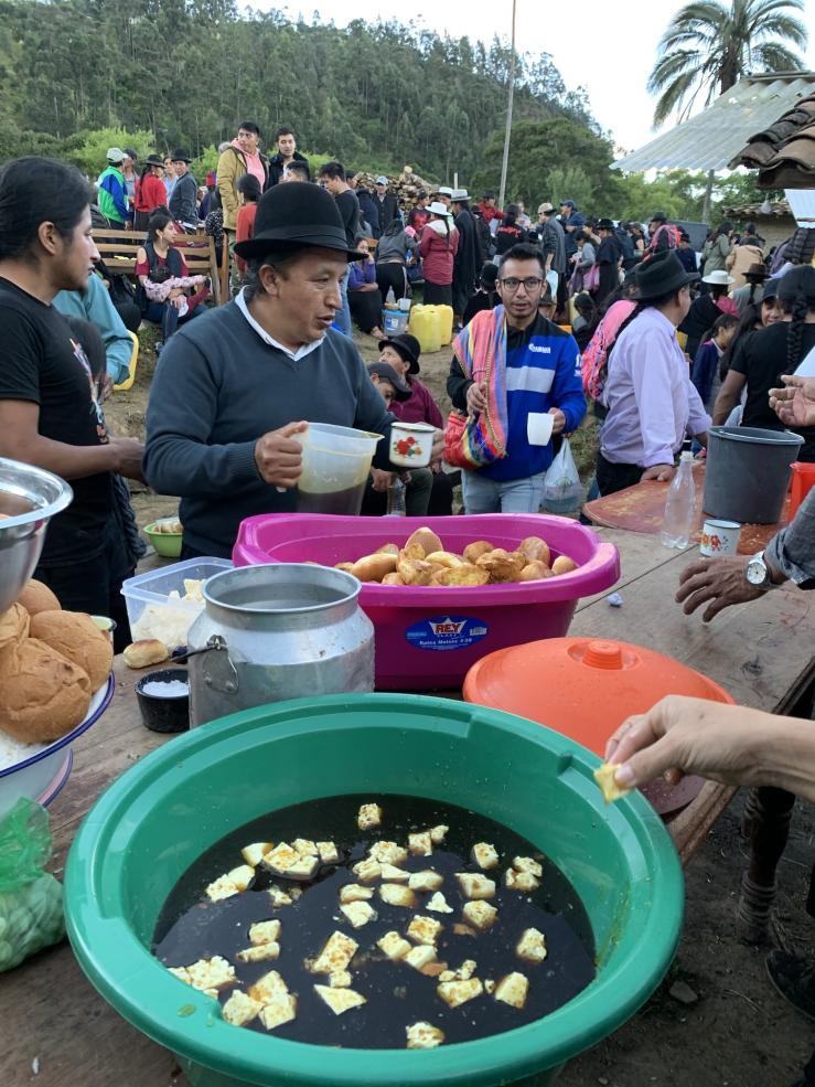 Serving food at the community gathering