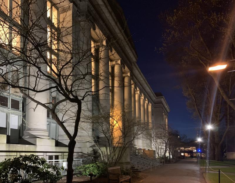 The Harvard Law School building at night