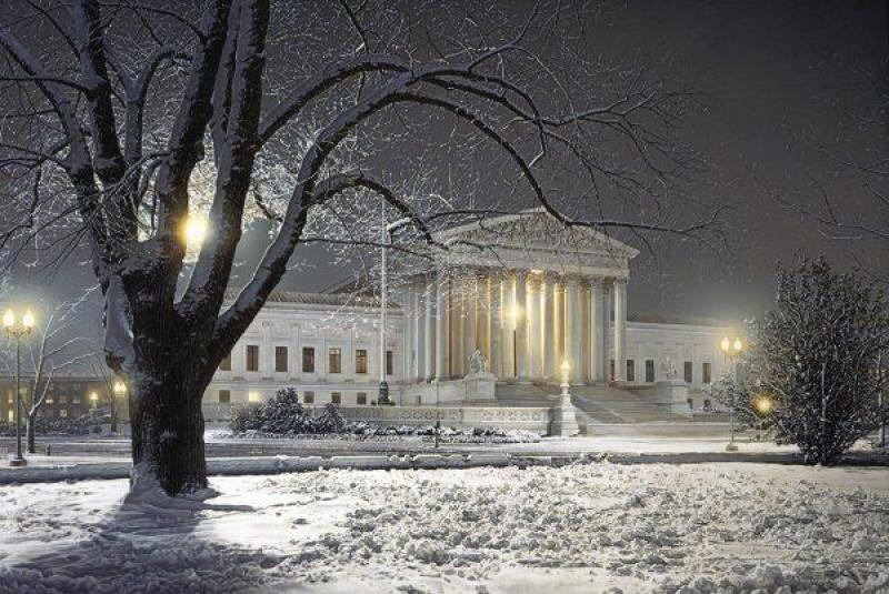A picture of the Supreme Court amid a snowy background