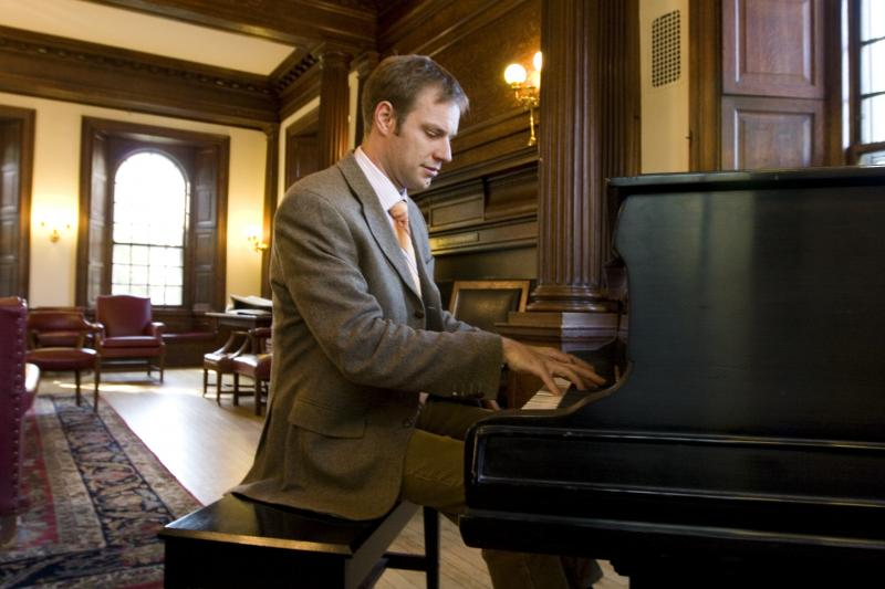 Professor Alexander Rehding was photographed by the grand piano at Phillips Brooks House.
