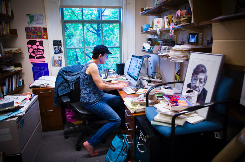 Professor Stephanie Burt works in her office, located in the Barker Center.