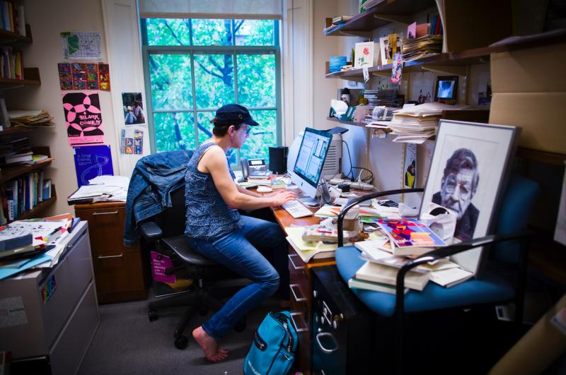 Professor Stephanie Burt works in her office, located in the Barker Center.