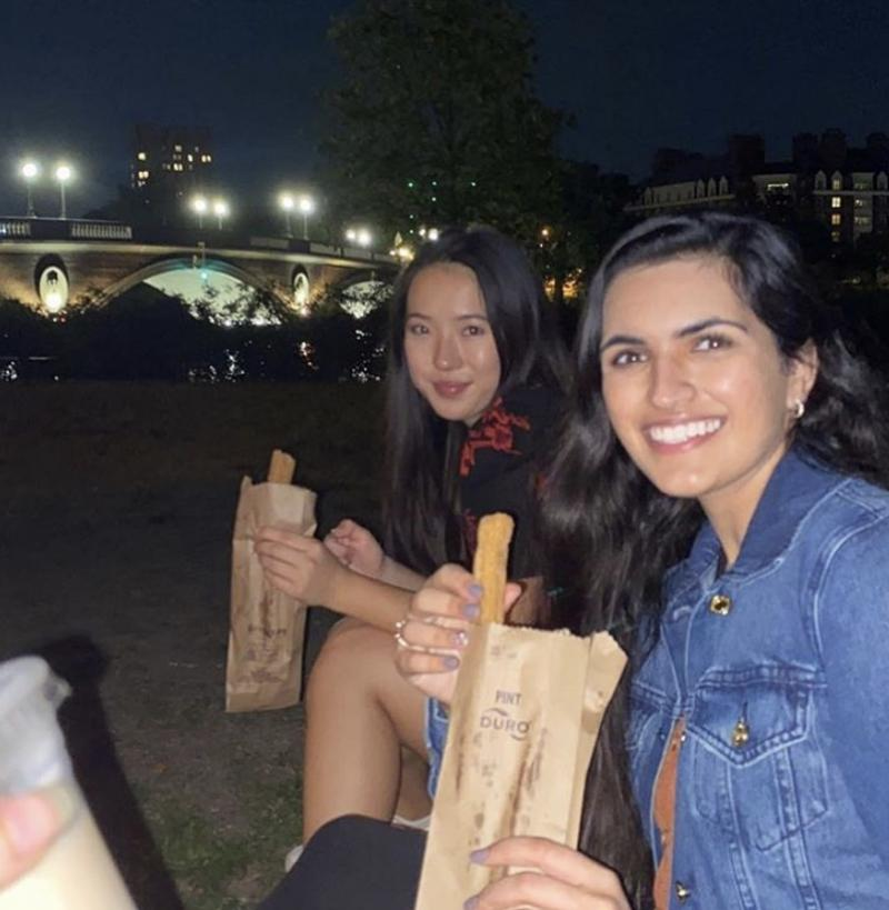 Image of my friends eating churros by the Charles River
