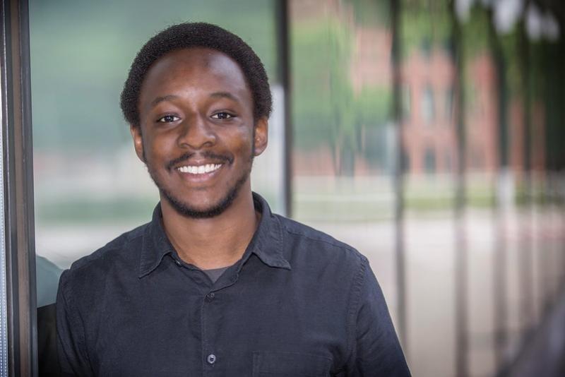 A headshot of professor Demba Ba.
