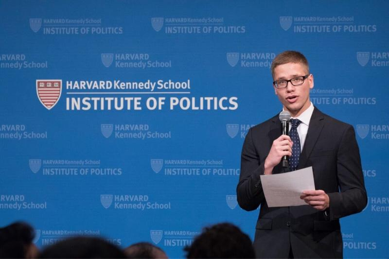 A student speaking to an audience at the Institute of Politics
