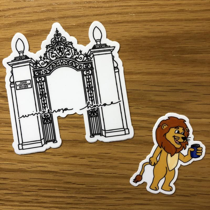 Photo of two stickers - a gate and a lion