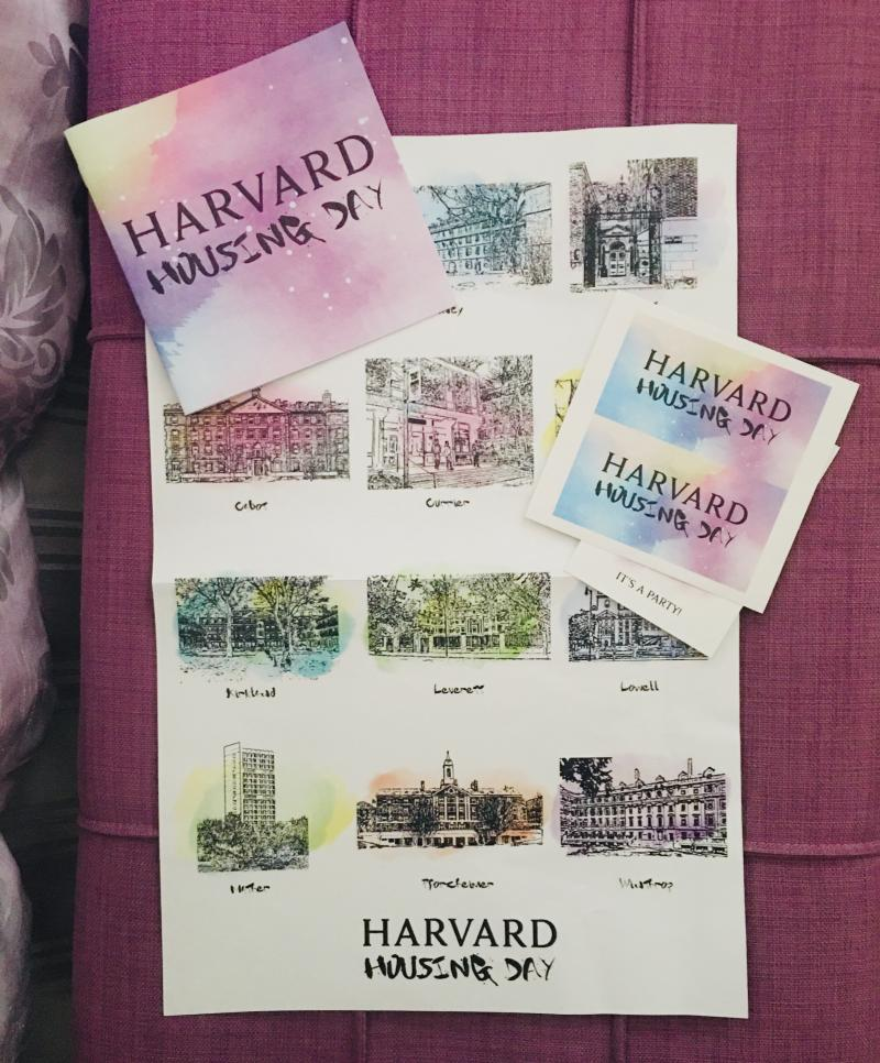 The contents from my Housing Day package: a watercolor poster of all the 12 houses, some stickers, and a booklet detailing the history, traditions, and a welcome from each house