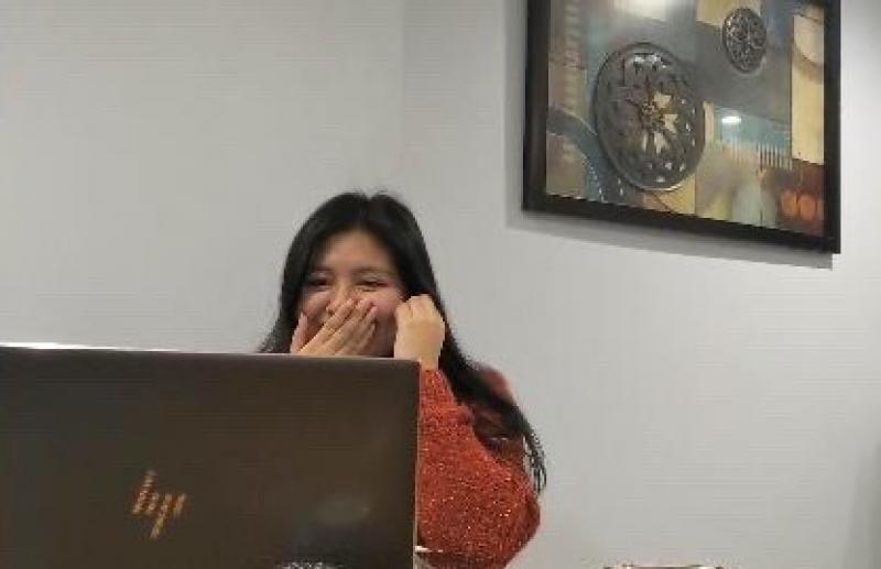 A girl on a laptop.