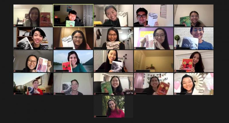 Group of smiling students on Zoom holding up books