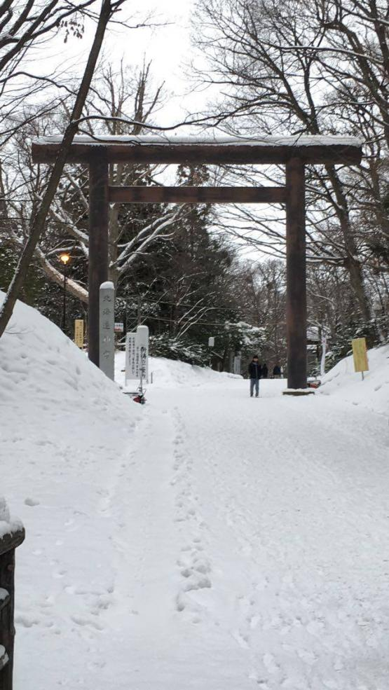 Wooden shrine gate in the snow