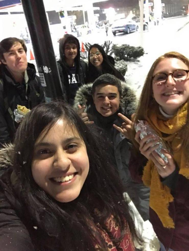 Group of students standing in the snow smiling