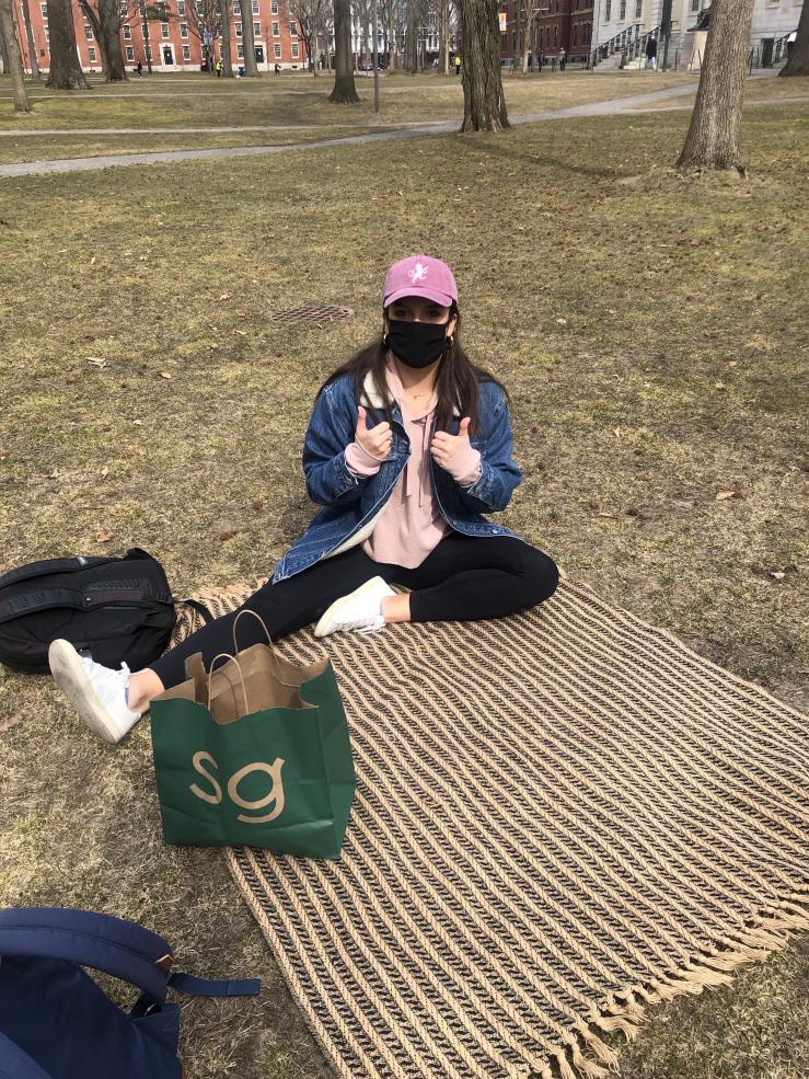 My friend sitting in Harvard Yard