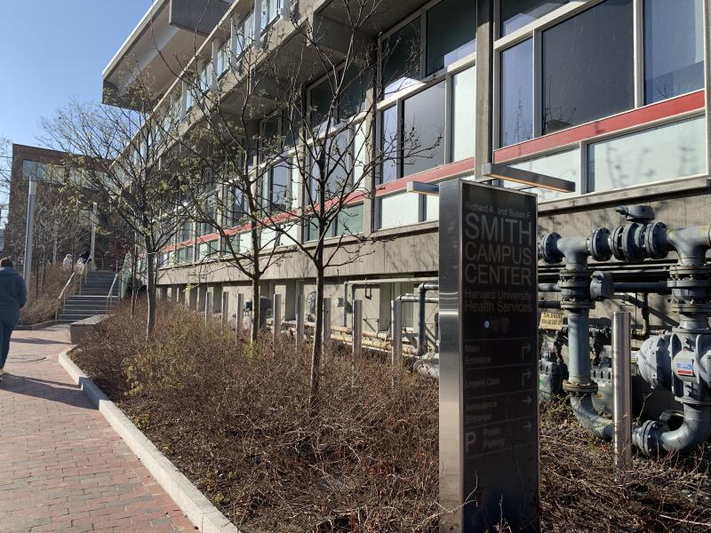 Mt. Auburn Street Side of Harvard University Health Services showing the sidewalk, building and the entrance sign