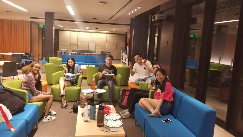 6 students sitting in common room couches