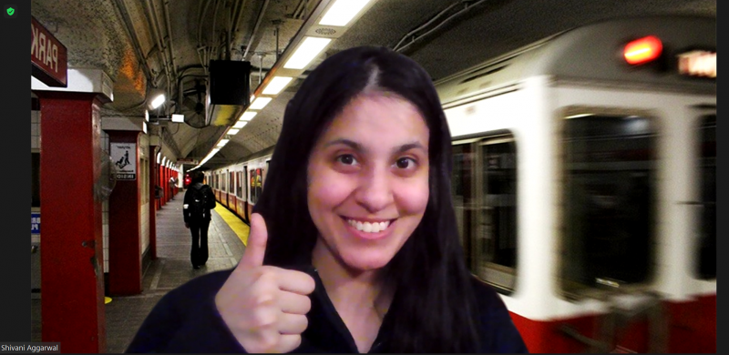 Girl smiling in front of a virtual background of a subway station