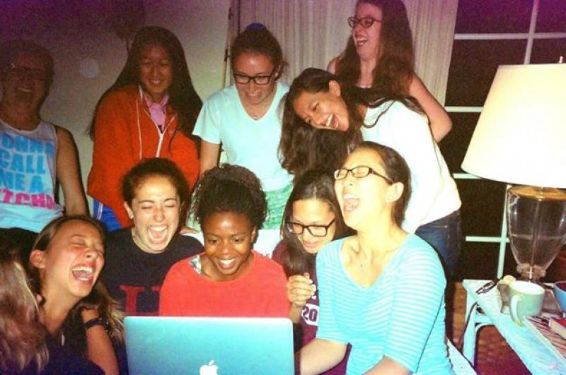 Author laughing with a cappella group over a YouTube video