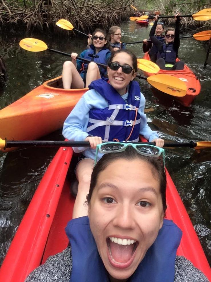 Author kayaking with her a cappella group