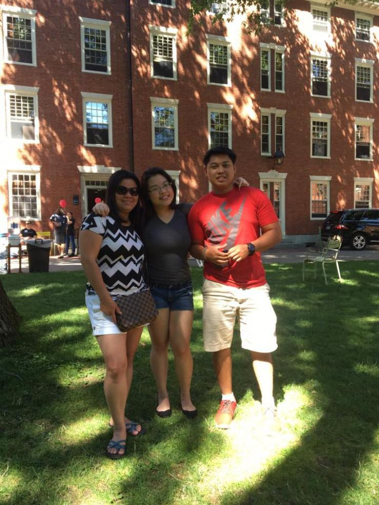 Family in front of Stoughton dormitory
