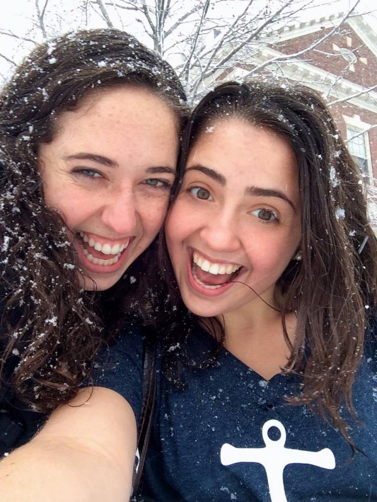 Author taking selfie in snow with friend