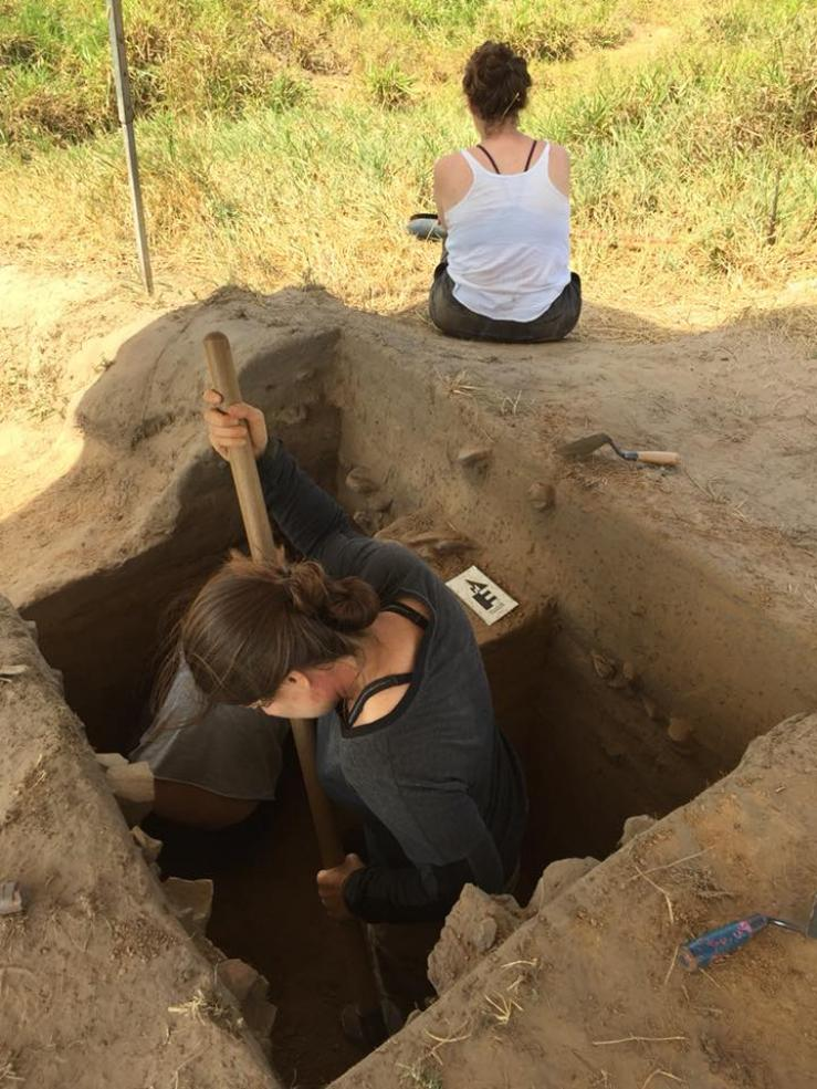 student excavating for archeological dig
